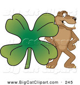Big Cat Cartoon Vector Clipart of a Brown Cougar Mascot Character with a Clover by Toons4Biz