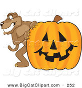 Big Cat Cartoon Vector Clipart of a Happy Cougar Mascot Character with a Pumpkin by Toons4Biz
