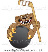 Big Cat Cartoon Vector Clipart of an Aggressive Cougar Mascot Character Grasping a Hockey Puck by Toons4Biz