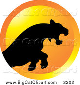 Big Cat Vector Clipart of a Silhouetted Leaping Puma or Tiger over an Orange Circle by Lal Perera