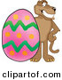 Big Cat Cartoon Vector Clipart of a Grinning Cougar Mascot Character with an Easter Egg by Toons4Biz