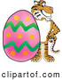 Big Cat Cartoon Vector Clipart of a Grinning Tiger Character School Mascot with an Easter Egg by Toons4Biz
