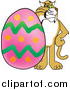 Big Cat Vector Clipart of a Bobcat with an Easter Egg by Toons4Biz